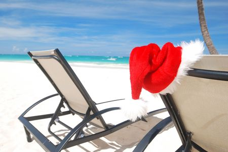 chaise lounge: Santas hat and chaise lounge on the beach