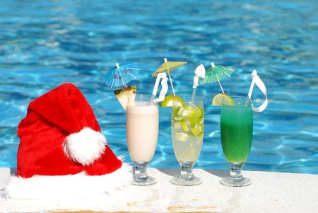 Santa hat and cocktails near the swimming pool photo