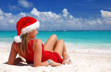 Woman on the beach in santa's hat Stock Photo - 3653684