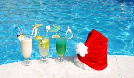 luxury party: Santa hat and cocktails near the swimming pool Stock Photo