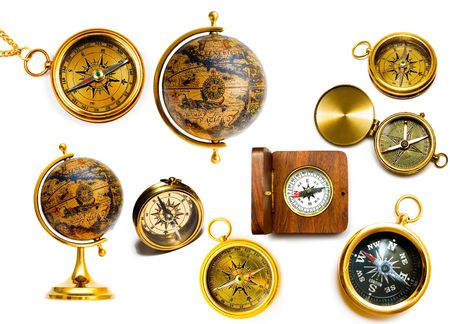 Old style compasses and globes isolated on white background photo