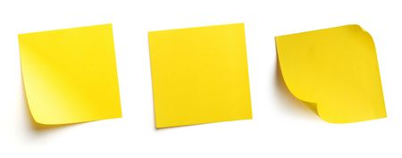 Yellow blank post-it notes isolated on white photo