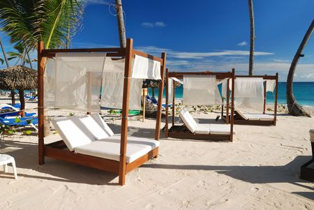 chaise lounge: Luxury wooden chaise lounge on beautiful caribbean beach in Dominican Republic Stock Photo