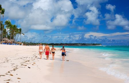 Beautiful caribbean beach in Dominican Republic. Unrecognizable people.