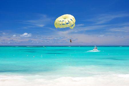 unrecognizable people: Beautiful caribbean beach in Dominican Republic. Unrecognizable people.