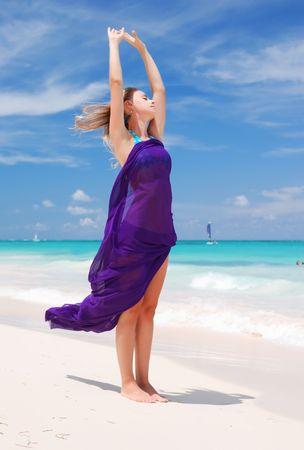 sarong: Woman with sarong on caribbean beach