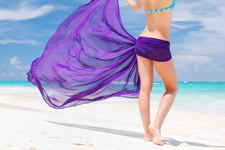 Woman with sarong on caribbean beach photo
