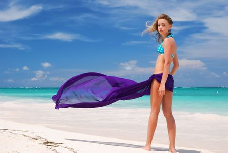 Woman with sarong on caribbean beach Stock Photo - 4506016