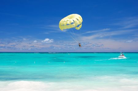 paraglide: Beautiful caribbean beach in Dominican Republic. Unrecognizable people.