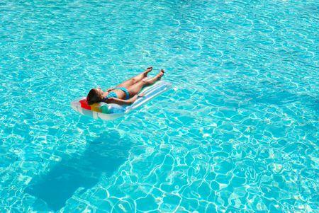 swimming pool float: Girl in resort swimming pool