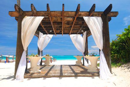 bolster: Beautiful caribbean beach with pergola in Dominican Republic