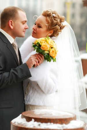 Winter wedding. Bride and groom outdoors. Stock Photo