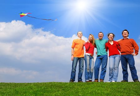 Group of people smiling against blue sky Stock Photo - 4993438