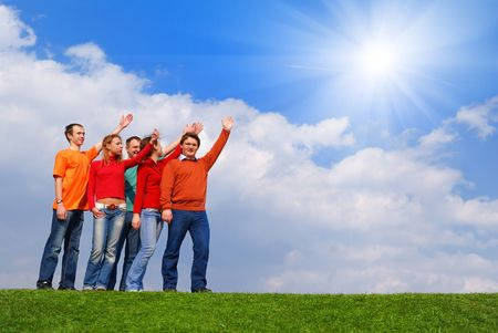 Group of people pointing to sky with clouds                 Stock Photo - 4993442