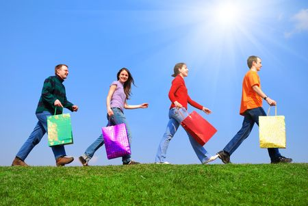 People with bags against blue sky Stock Photo - 5028897