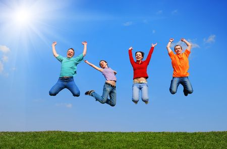 People jumping against blue sky Stock Photo - 4999734