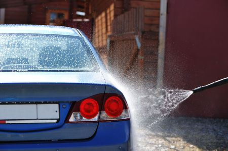 Blue car washing on open air photo