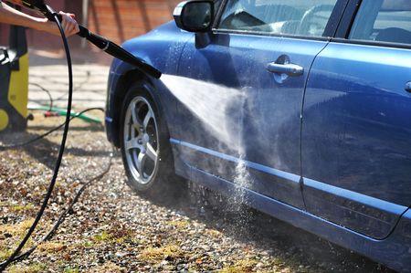Blue car washing on open air photo