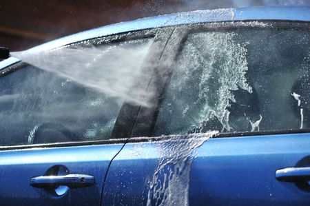 sprays: Blue car washing on open air Stock Photo