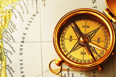 Antique Brass Compass Over Old Canadian Map Background Stock Photo - Antiques us maps with compass