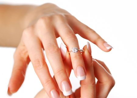 jewel hands: Woman tries on her diamond engagement ring Stock Photo