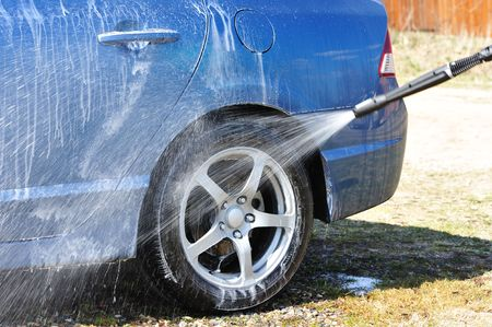 wash car: Blue car washing on open air Stock Photo