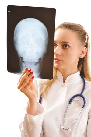Doctor looking at x-ray (isolated on white) photo