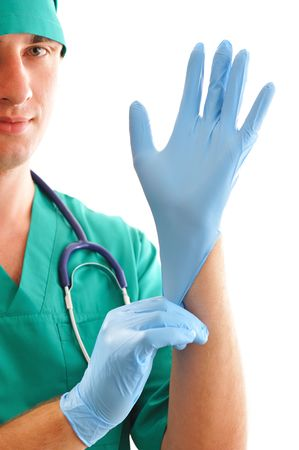 Doctor pulling on surgical glove Stock Photo - 5306268