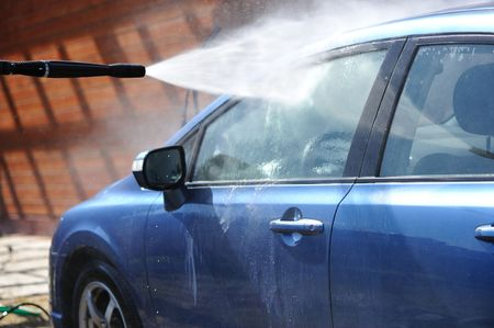 hand washing: Blue car washing on open air Stock Photo