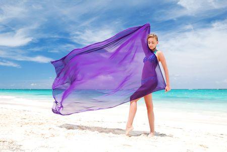 Woman with sarong on caribbean beach photo