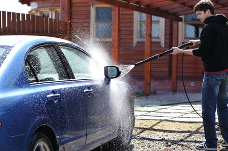wash hand: Blue car washing on open air Stock Photo