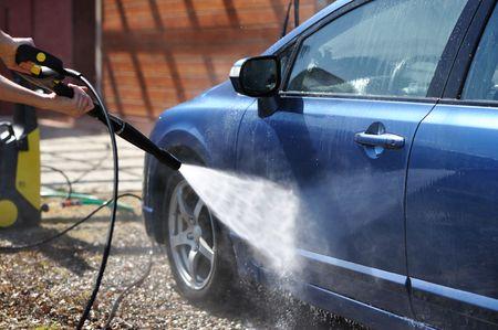 shiny car: Blue car washing on open air Stock Photo