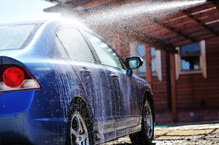 washing hands: Blue car washing on open air Stock Photo