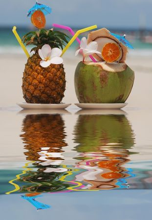pina: Tropical cocktails on the beach. Reflection in water.