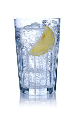 Water glass with ice & lemon isolated on white. Soft reflection. photo