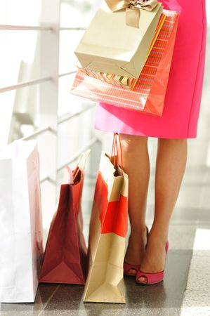Woman with bags in shopping mall Stock Photo - 5443453