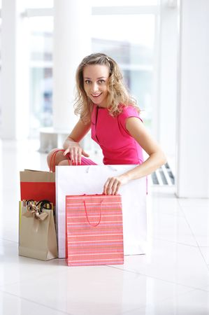 Woman with bags in shopping mall Stock Photo - 5474685