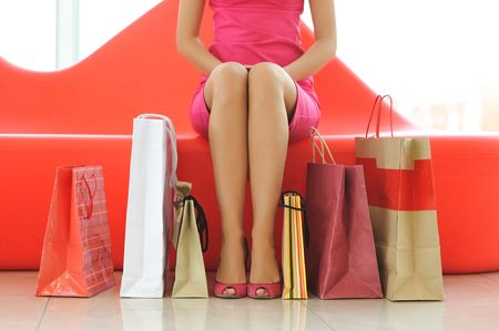 shopaholics: Woman with bags in shopping mall