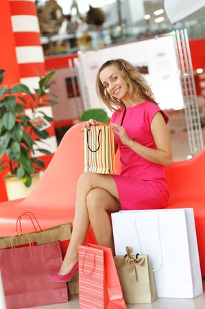 Woman with bags in shopping mall Stock Photo - 5459328