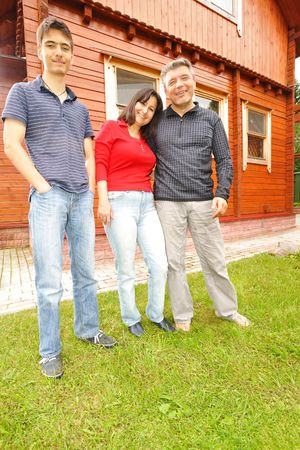 Family in front of their house Stock Photo - 5490840