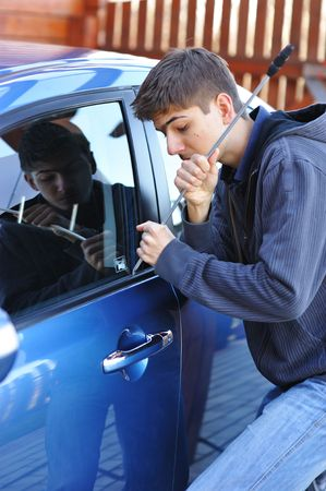 Young man trying to steal a car Stock Photo - 5494994