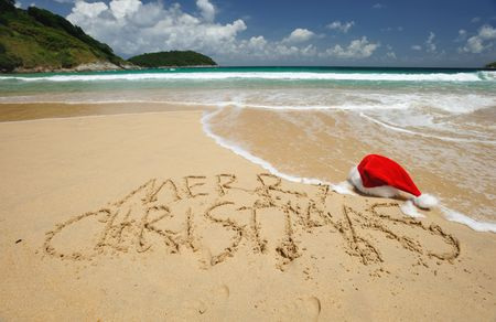 Santa's hat on a tropical beach Stock Photo - 5502907