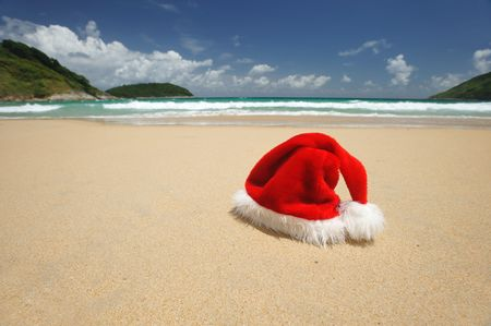 Santa's hat on a tropical beach Stock Photo - 5502906
