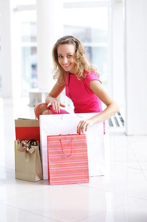 Woman with bags in shopping mall Stock Photo - 5518674