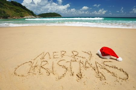tranquil scene: Santas hat on a tropical beach