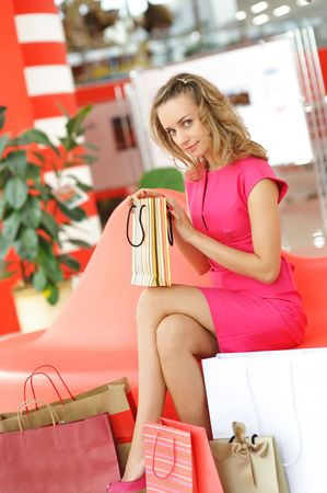 Woman with bags in shopping mall Stock Photo - 5645534