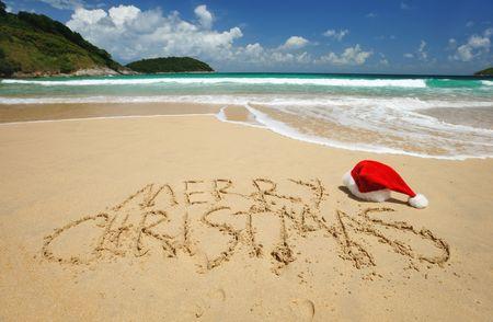 caribbean sea: Santas hat on a tropical beach