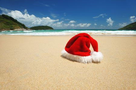 Santas hat on a tropical beach photo