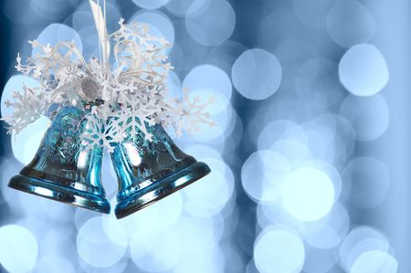 jingle: Christmas bells against defocused background with shallow depth of field and copyspace
