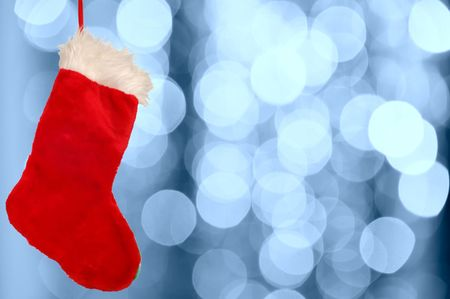 Christmas stocking against defocused background with shallow depth of field and copyspace photo